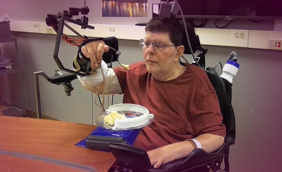 Paralyzed man uses experimental device